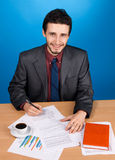 Young handsome businessman working with documents Stock Images