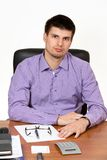 Young handsome businessman working at his desk stock photos