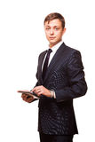 Young handsome businessman is working on his digital tablet isolated on white background Royalty Free Stock Photography