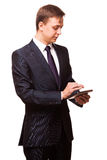 Young handsome businessman is working on his digital tablet isolated on white background Royalty Free Stock Photos