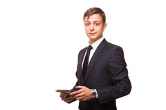 Young handsome businessman is working on his digital tablet isolated on white background Stock Photos