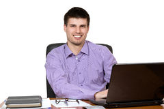 Young handsome businessman working on laptop Stock Images