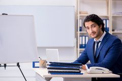 The young handsome businessman working in the office. Young handsome businessman working in the office royalty free stock photography