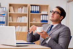 The young handsome businessman working on office. Young handsome businessman working on office Royalty Free Stock Images
