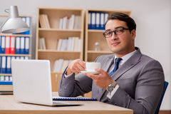 The young handsome businessman working on office. Young handsome businessman working on office Stock Images