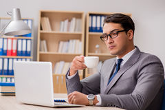 The young handsome businessman working on office. Young handsome businessman working on office Royalty Free Stock Image