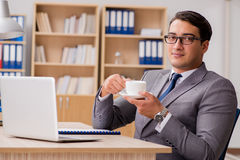 The young handsome businessman working on office. Young handsome businessman working on office Stock Photos