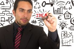 Young handsome businessman writing on whiteboard Royalty Free Stock Image
