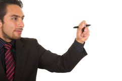 Young handsome businessman writing on whiteboard Royalty Free Stock Images