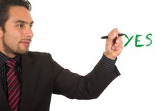 Young handsome businessman writing on whiteboard Royalty Free Stock Photo