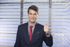 Young handsome businessmen showing thumb-up in the office Royalty Free Stock Photography