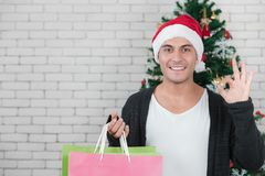 Young and handsome caucasian man in red hat holding several size royalty free stock photos