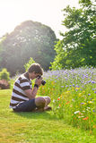Young handsome caucasian photographer in botanic gardens. Stock Photography