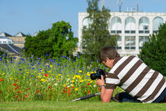 Young handsome caucasian photographer in botanic gardens. Royalty Free Stock Photography