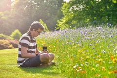 Young handsome caucasian photographer in botanic gardens. Stock Images