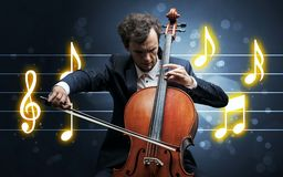 Young cellist with music sheet. Young handsome cellist playing with music sheet background stock image