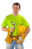 A young handsome construction contractor with tools standing hol Royalty Free Stock Photo