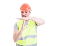Young handsome constructor doing time out gesture Stock Images