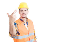 Young handsome constructor or engineer holding crossed fingers a. Nd smile as good luck or wish gesture concept with copypaste on white studio background Stock Images