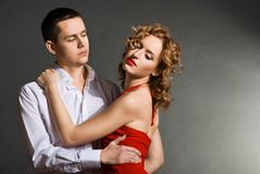 Young handsome couple in elegant evening dresses Stock Photos
