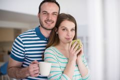 Young handsome couple enjoying morning coffee Stock Images