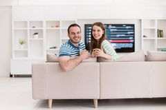 Young handsome couple enjoying morning coffee Royalty Free Stock Photo