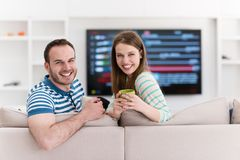 Young handsome couple enjoying morning coffee Royalty Free Stock Photos