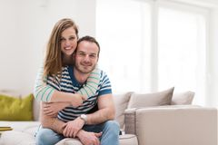 Young handsome couple hugging on the sofa Royalty Free Stock Photo