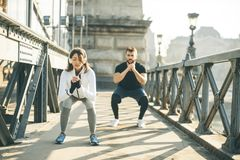 Young couple have training in urban enviroment stock photography