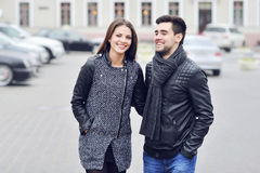 Young handsome couple having fun in an old town - casual portrai Royalty Free Stock Photo