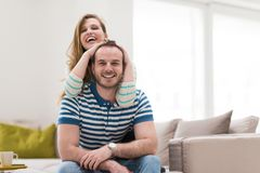 Young handsome couple hugging on the sofa Stock Image