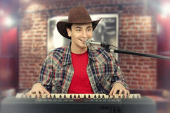 Young handsome cowboy singing Royalty Free Stock Photos