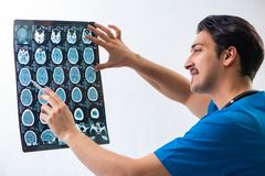 Young handsome doctor radiologyst working in hospital stock photo