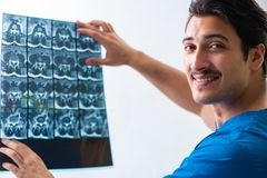 Young handsome doctor radiologyst working in hospital royalty free stock photo