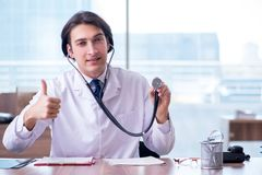 Young handsome doctor working in the clinic. The young handsome doctor working in the clinic royalty free stock images
