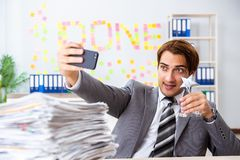 The young handsome employee sitting at the office stock photos