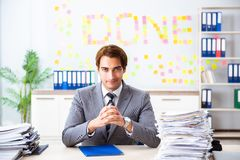 The young handsome employee sitting at the office royalty free stock photography