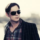 Young handsome fashion man in sunglasses outdoor royalty free stock photos