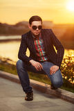 Young handsome fashion man in sunglasses at sunset Royalty Free Stock Photos