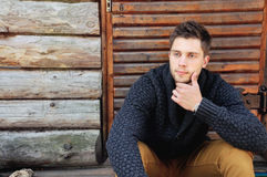 Young handsome fashionable man by the wooden coutry house Stock Image