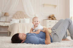 Young handsome father and cute son at the home Royalty Free Stock Images