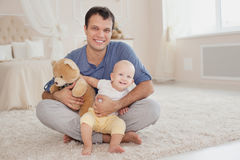Young handsome father and cute son at the home Stock Photography