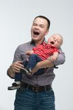 Young handsome father and his toddler son yawning Stock Images