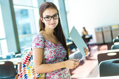 Young handsome female student at the college Royalty Free Stock Photography