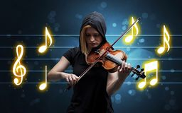 Young fiddler with music sheet royalty free stock images