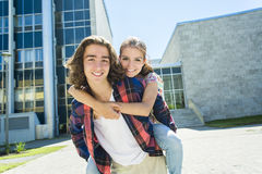 Young handsome friend student at the college Royalty Free Stock Photo