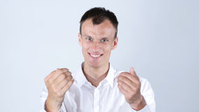 Young handsome friendly happy man and shows with arms come here , invite. High quality Royalty Free Stock Image