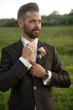 Young handsome groom portrait in nature Royalty Free Stock Images