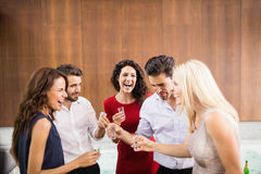 Young and handsome group of friends drinking shots. At the party royalty free stock photography