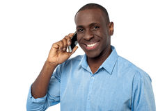 Young handsome guy attending a phone call Stock Images